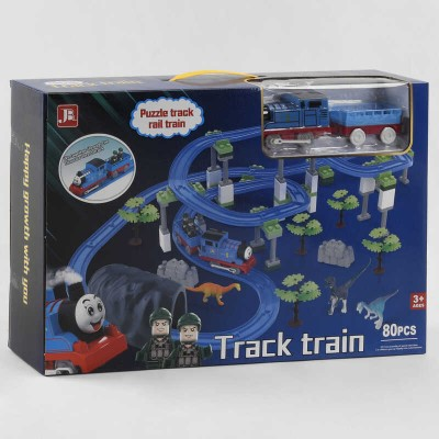 Железная дорога 599-28 A (18) на батарейках, 80 деталей, локомотив, вагон, 2 фигурки, 3 динозавра, декорации, аксессуары, звук, в коробке