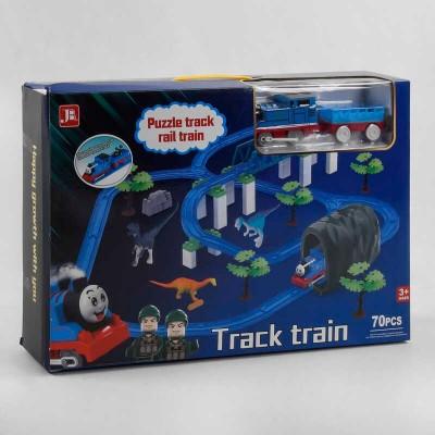 Железная дорога 599-27 A (18) на батарейках, 70 деталей, локомотив, вагон, 2 фигурки, 3 динозавра, декорации, аксессуары, звук, в коробке